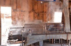 Steel condenser for maple syrup in operation Stock Photography