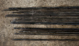 Steel conduits in garage lay on the ground Stock Photo