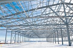 Steel construction on the background of the winter landscape. The structure of the building. Steel construction on the background of the winter landscape royalty free stock photography