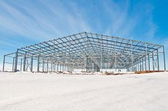 Steel construction on the background of the winter landscape. The structure of the building. Steel construction on the background of the winter landscape stock photography
