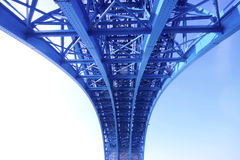 Steel Construction Of The Railway Bridge. Blue painted steel construction of railway bridge across the Drava river in Maribor, Slovenia with railway tracks and royalty free stock photos