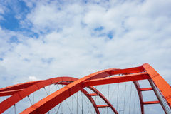 The steel construction of the red bridge Stock Photo