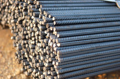 Steel on construction site. A tied bundle of cold steel bars on construction site Stock Photography