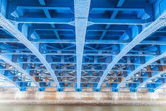 Steel construction from under the bridge. Perspective of Steel construction from under the bridge Stock Photos