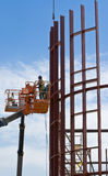 Steel construction workers and Royalty Free Stock Photos