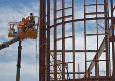 Steel construction workers and Royalty Free Stock Images