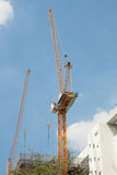 Steel crane with building constuction Royalty Free Stock Photography