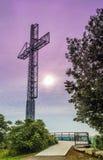 Steel Cross on Hill Stock Image