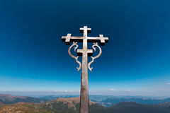Steel cross on hill of the mountain Ukraine Royalty Free Stock Image