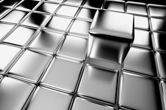 Steel cube standing out in crowd Royalty Free Stock Photography