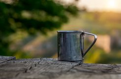 Steel cup on the background of a tourist tent. royalty free stock image