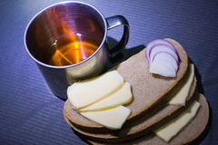 Steel cup, bread, cheese and onion Royalty Free Stock Images