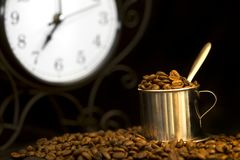 Steel cup of coffee and clock Royalty Free Stock Image