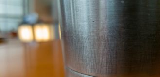 Steel Cup on a Wood Table in the Foyer royalty free stock images