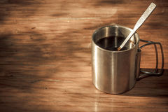 Steel cup on a wooden table Stock Images