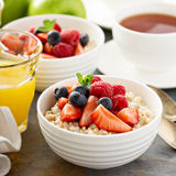 Steel cut oatmeal porridge with fresh berries Stock Images