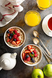 Steel cut oatmeal porridge with fresh berries. For breakfast overhead shot Stock Image