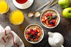 Steel cut oatmeal porridge with fresh berries. For breakfast overhead shot Stock Images