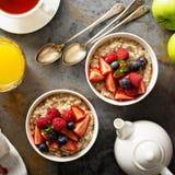 Steel cut oatmeal porridge with fresh berries. For breakfast overhead shot Royalty Free Stock Photography