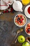 Steel cut oatmeal porridge with fresh berries. For breakfast overhead shot with copyspace Royalty Free Stock Photo