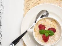 Steel cut oatmeal porridge with raspberry and almond flakes for. Steel cut oatmeal porridge with raspberry and almondflakes for breakfast Stock Images