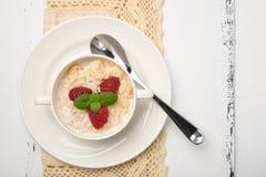 Steel cut oatmeal porridge with raspberry and almond flakes for. Steel cut oatmeal porridge with raspberry and almondflakes for breakfast Stock Photo