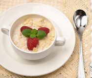 Steel cut oatmeal porridge with raspberry and almond flakes for. Steel cut oatmeal porridge with raspberry and almondflakes for breakfast Royalty Free Stock Photography