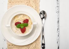 Steel cut oatmeal porridge with raspberry and almond flakes for. Steel cut oatmeal porridge with raspberry and almondflakes for breakfast Royalty Free Stock Photo