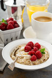 Steel cut oatmeal porridge with raspberry and coconut. Flakes for breakfast Stock Photography