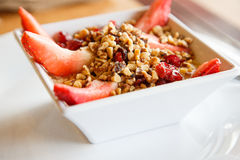 Oatmeal with Walnuts and Fresh Strawberries Stock Images