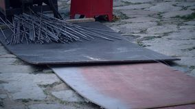 Steel cutter and some of steel. On the stone floor royalty free stock photo