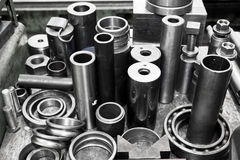 Steel cylinders, pistons and tools in workshop. Industry theme. Stock Photography