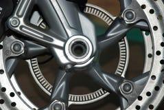 Steel disk of motorbike wheel. Steel gray disk of motorbike wheel. Parts Stock Photos