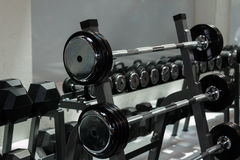Steel Disks and Barbells in Gym: Weight Fitness Equipment.  Stock Photography