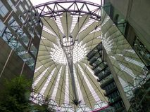Steel dome of the forum of the Sony center in the famous Postdamer Platz. Symbol of the contemporary Berlin. Steel dome of the forum of the Sony center in the stock images
