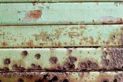 Steel door. Abstract green steel door with rusty Stock Photos