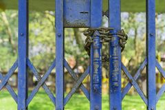 Steel door blue of lock by chain.  Royalty Free Stock Photo