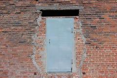 Steel door in the brick wall Royalty Free Stock Image