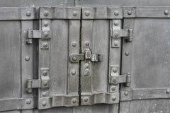 Steel door in the door. Small steel Door in Door Stock Image