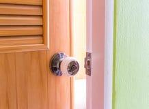 A steel door knob are open. In home stock photo