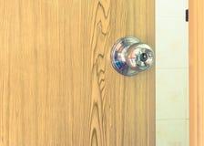 Steel door knob on the pvc door,vintage effect filter Stock Images
