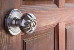 Steel door knob on the wooden door Stock Photos