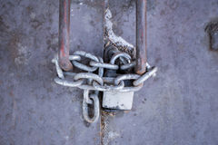 Steel door with lock and chain. Stock Photos