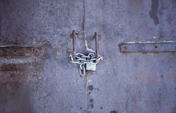 Steel door with lock and chain. Royalty Free Stock Photo