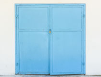 Steel door and padlock on white wall Royalty Free Stock Photo