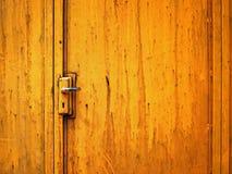 Steel door painted Orange color Stock Photography