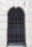 Steel door in stone wall Royalty Free Stock Image