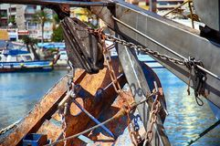 Details of iron doors in a trawler fishing boat docked in Calpe. Steel doors, chains and pulleys on the stern of a fishing boat docked in port Royalty Free Stock Photography