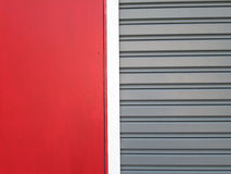 Steel doors with red wall Stock Image