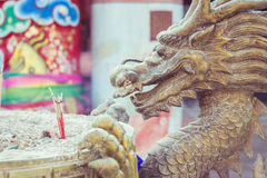 Steel dragon statue on incense bucket in Chinese temple Royalty Free Stock Images